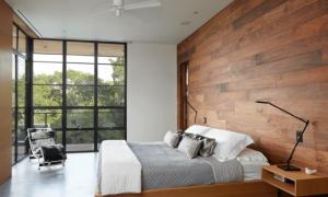 Ламинат на стене в спальне (30 фото): дизайн интерьера с отделкой стен