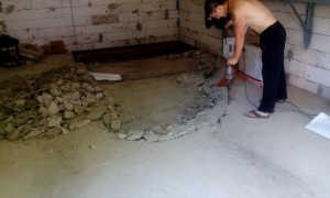 Демонтаж стяжки: снятие старой бетонной или цементной стяжки пола